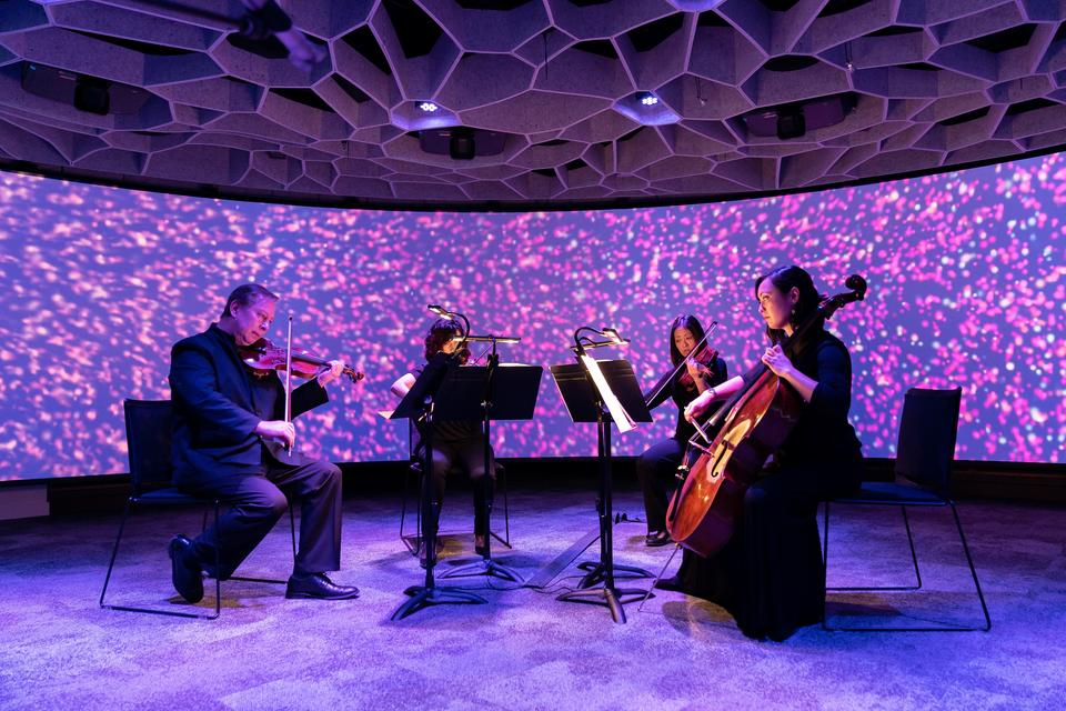 Seattle Symphony Orchestra musicians demonstrate the Octave 9 space